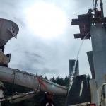 Hoonah- Putz TK70 pumping flowable grout through tremie to fill pilings and float out water.