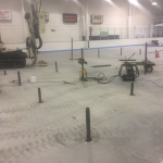 "Boeke Ice Arena - A large area about 40' in diameter in the center of the rink settled up to 3"". Compaction grouting was used with low-mobility grout injected down to 18' to stabilize soft layers and raise the slab. Injection pipes had to inserted between coolant tubes 3"" on center."
