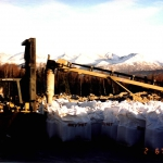 Lowell Cr-2003 MCGA filled super bags with project-specific aggregates in Anchorage and shipped to Seward for batching.