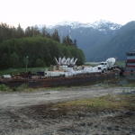 Tyee Lk-Truck, pump, and super bags of concrete materials arriving by barge to the end of Bradfield Canal near Wrangell.